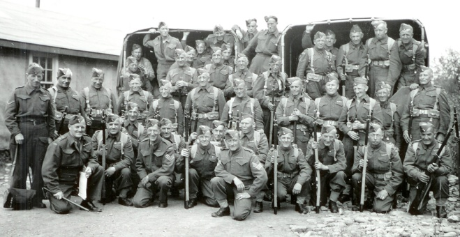 """No. 23 Company, Veterans Guard of Canada. Lieut. Colin """"Scotty"""" Mann is kneeling, front left."""