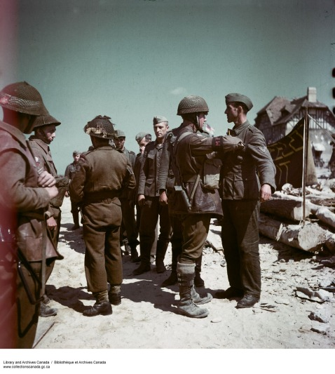German PoWs being searched by Canadian guards - Library and Archives Canada