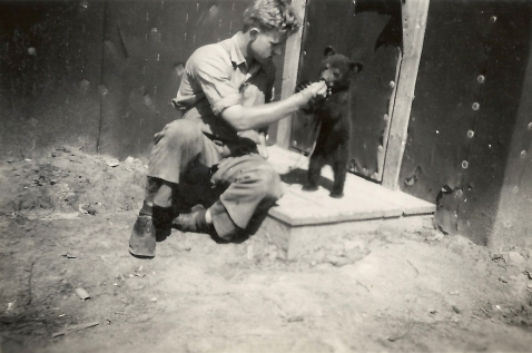 POW and pet bear, Pigeon Timber Co. Camp near Neys.